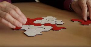 Penrose with the puzzle in the documentary